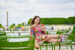 Young Parisian woman in the Tuileries garden Royalty Free Stock Photo