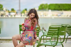 Young Parisian woman in the Tuileries garden Royalty Free Stock Image