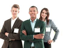 Young participants of the conference with blank badges,. Standing in office stock image
