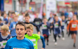 Young participants hurrying to finish line during kids section of `Dnepr Eco Marathon` race Royalty Free Stock Images