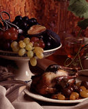 Young partridge with grapes Stock Photo
