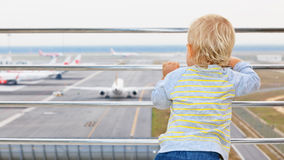 Young passenger looks at the plane in airport royalty free stock image