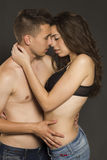 Young passion couple kissing in studio Royalty Free Stock Image