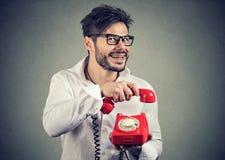 Crazy man hanging up phone stock photos