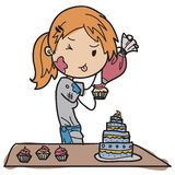 Young pastry chef. Decorating her pastry Royalty Free Stock Photo