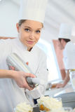 Young pastry cook preparing desserts Stock Photos