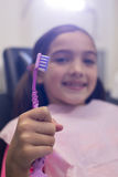 Young patient holding her toothbrush Stock Image