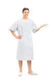 Young patient in a hospital gown gesturing with hand Stock Photos