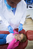 Young patient scared during a dental check-up Stock Photo
