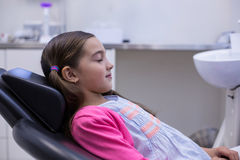 Young patient sitting on dentists chair Royalty Free Stock Photo