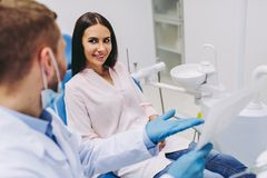 Patient talking with dentist looking at x-ray royalty free stock images