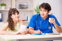 Young patient visiting doctor cardiologist. The young patient visiting doctor cardiologist royalty free stock images