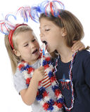 Young Patriots Sharing Licks Stock Photos