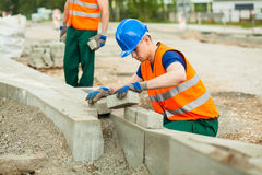 Young paver at work Royalty Free Stock Images