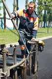 Young paver worker at asphalting stock photo