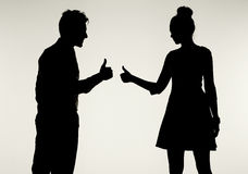 Young and peaceful couple showing OK gesture Royalty Free Stock Photos
