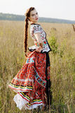 Young peasant woman, dressed in Hungarian national costume, posing over nature background Royalty Free Stock Photos