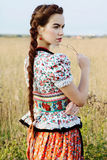 Young peasant woman, dressed in Hungarian national costume, posing over nature background Royalty Free Stock Photography