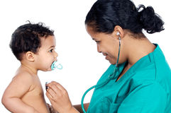 Young pediatrician with baby stock photo