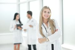 Young pediatrician doctor standing in the hallway of the medical center. Photo with copy space stock photos
