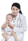 Young pediatrician and female baby Stock Image