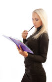 Young pensive blonde holding notebook Stock Photo
