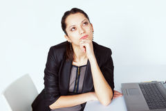 Young pensive business woman Royalty Free Stock Photo