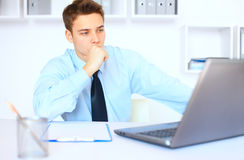 Young pensive businessman at his workplace Stock Photography