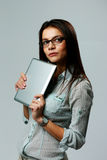 Young pensive businesswoman holding tablet computer Royalty Free Stock Image
