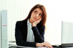 Young pensive businesswoman looking away at copyspace Royalty Free Stock Image