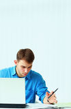 Young pensive casual businessman reading document Stock Photo