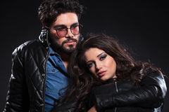 Young pensive couple in leather jackets Stock Photo