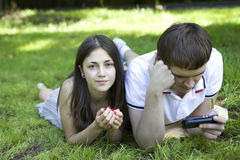 Young pensive couple lying Stock Images