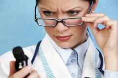 Young pensive female doctor Royalty Free Stock Images