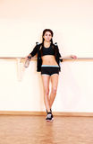 Young pensive fit woman standing. At gym Royalty Free Stock Images