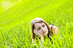 Young pensive on the grass Royalty Free Stock Photos