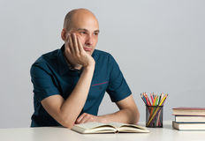 Young pensive man with book Royalty Free Stock Photo