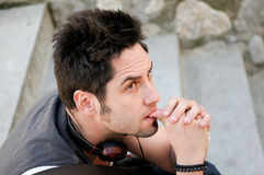 Young pensive man with headphones Royalty Free Stock Photography