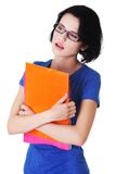 Young pensive student holding her notes Stock Images