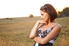 Young pensive woman Stock Photography