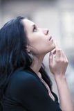 Young pensive woman looking up portrait. Shallow dof royalty free stock photos