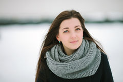 Young pensive woman in scarf and coat closeup winter outdoors Stock Photography