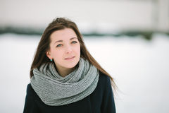 Young pensive woman in scarf and coat closeup winter outdoors Stock Photos