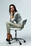 Young pensive woman sitting on the office chair Stock Images