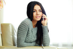 Young pensive woman talking on the phone Royalty Free Stock Photos