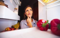 Free Young Pensive Woman Thinking Near Opened Fridge Stock Photos - 172367043