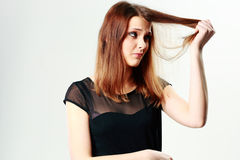 Young pensive woman touching her hair Royalty Free Stock Image