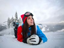 Young pensive woman in winter in snowy forest on top of mountain Stock Images
