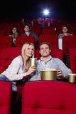 Young people. Attractive young people are watching movies in cinema Royalty Free Stock Photography