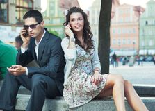 Young people. Talking by phones Royalty Free Stock Photos